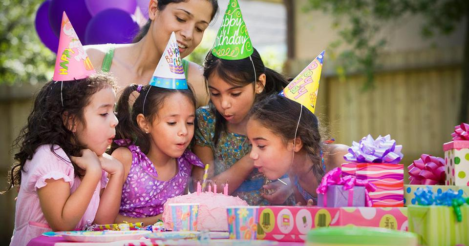 kids at a birthday party, blowing out birthday candles