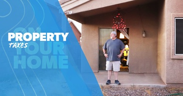 A man standing on the back porch of his home is thinking about property taxes.