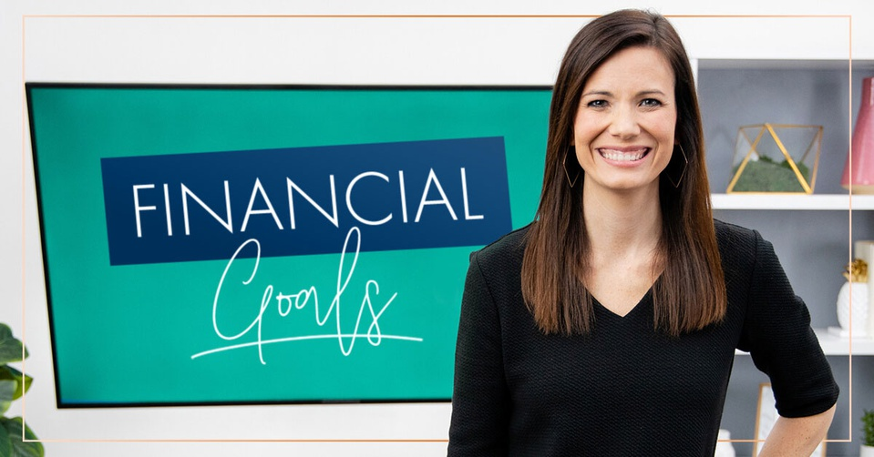 Rachel Cruze standing in front of a screen that says financial goals.