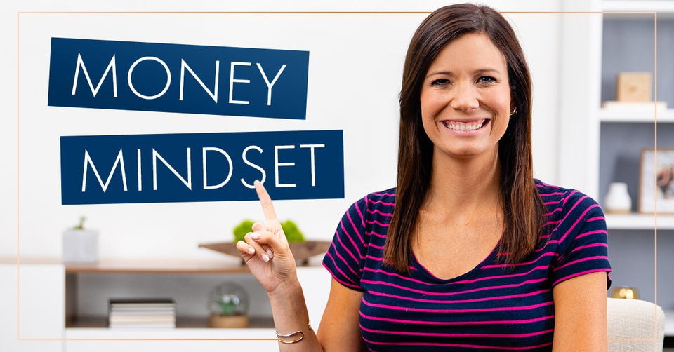 Rachel Cruze pointing to a sign that says money mindset.