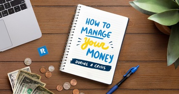 How to manage your money during a crisis written on a notebook surrounded by money and a laptop and pen